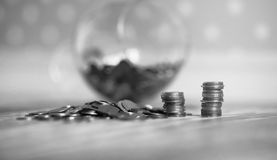 Coins in a jar on the floor. Accumulated coins on the floor. Sav Royalty Free Stock Image
