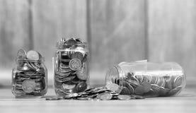 Coins in a jar on the floor. Accumulated coins on the floor. Sav Royalty Free Stock Photo
