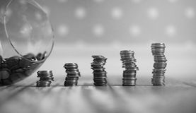 Coins in a jar on the floor. Accumulated coins on the floor. Sav Royalty Free Stock Images