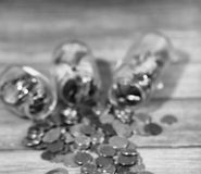 Coins in a jar on the floor. Accumulated coins on the floor. Sav. Coins in a jar on the floor. Accumulated coins on the floor. Pocket savings in piles.r Royalty Free Stock Images