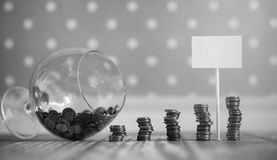 Coins in a jar on the floor. Accumulated coins on the floor. Sav. Coins in a jar on the floor. Accumulated coins on the floor. Pocket savings in piles.r Royalty Free Stock Photography