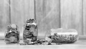 Coins in a jar on the floor. Accumulated coins on the floor. Sav. Coins in a jar on the floor. Accumulated coins on the floor. Pocket savings in piles.r Royalty Free Stock Photos