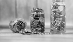Coins in a jar on the floor. Accumulated coins on the floor. Sav. Coins in a jar on the floor. Accumulated coins on the floor. Pocket savings in piles.r Stock Image