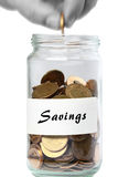 Coins jar savings man adding Stock Photos