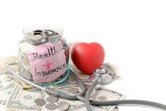 Coins in jar with stethoscope and banknote background stock photos