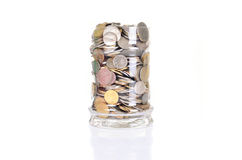 Coins in the jar Stock Photos
