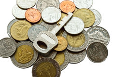 Coins   Key on white backgroud Royalty Free Stock Photography