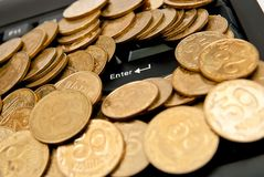 Coins on keyboard Royalty Free Stock Photography