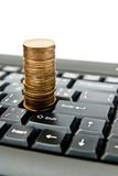 Coins on keyboard Royalty Free Stock Images