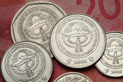 Coins of Kyrgyzstan. National emblem of Kyrgyzstan depicted in Kyrgyzstani som coins Stock Photo