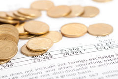 Coins laid out on document. Many ukrainian coins laid out on document with numbers Royalty Free Stock Photo