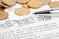 Coins laid out on document. Many ukrainian coins laid out on document with numbers Stock Photos