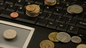 Coins on a laptop isolated on white background. Coins on a laptop isolated on white stock video footage