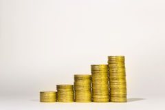 Coins lined up from short to tall stacks Royalty Free Stock Images