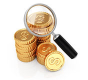 Coins and magnifier Royalty Free Stock Image