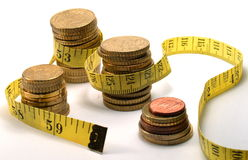 Coins and measuring tape Stock Photography
