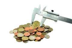 Coins and measuring tool Royalty Free Stock Images