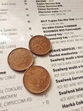 Coins and menu Stock Photo