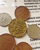 Coins and menu. Czech koruna coins and open menu book at cafe Stock Image
