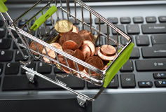 Coins in a metal basket Stock Photo