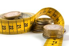 Coins with metre on white Stock Image