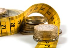 Coins with metre on white. Background Stock Images