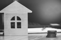 Coins and model of the house. real estate buying an apartment. mortgage. apartment for sale, contribution.  Royalty Free Stock Images