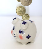 Coins and money box Stock Image