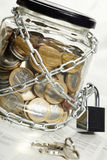 Coins in money jar Stock Images