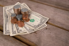 Coins & money on picnic table Stock Photo