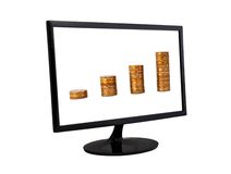 Coins in monitor Royalty Free Stock Photos