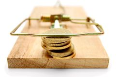 Coins in mousetrap. On a white background. Stock Photography
