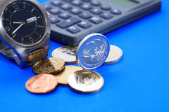 Coins Near Watch Stock Photos