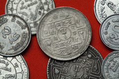 Coins of Nepal. Hindu trishul depicted in the Nepalese rupee coins Royalty Free Stock Photo