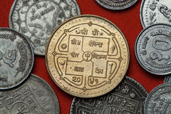 Coins of Nepal. Hindu trishul depicted in the Nepalese rupee coin