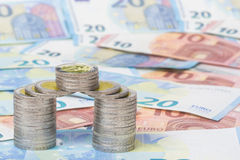 Coins and new euro bills Royalty Free Stock Photos