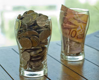 Coins and note drink for charity stock photos