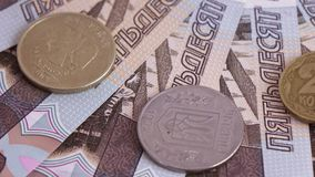 Coins and numbers on rubles. Rotation of new banknotes of Russian rubles with the numbers in order stock footage