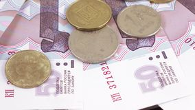 Coins and numbers on rubles. Rotation of new banknotes of Russian rubles with the numbers in order stock video footage