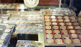 Coins at numismatics store Royalty Free Stock Image