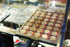 Coins  at numismatics store Royalty Free Stock Images
