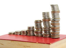 Coins & Old Book Royalty Free Stock Image
