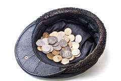 Coins in old cap Royalty Free Stock Photos