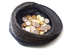Coins in old cap Stock Photo