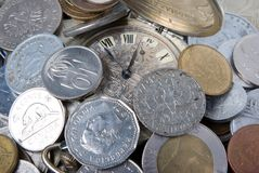 Coins and old watch Stock Images