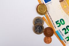 Free Coins On The Background Of Fifty Euro Banknotes, Close-up, Isolated On White Stock Photography - 215881552