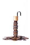 Coins and an open lock Royalty Free Stock Photos