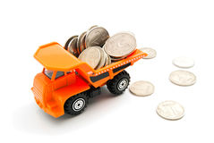 Coins and orange truck Stock Photos