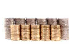 Coins organized in columns and rows isolated Royalty Free Stock Photo