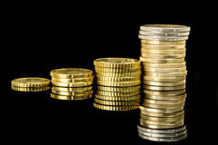 Coins over black Royalty Free Stock Photography